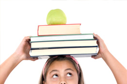 Young Girl Balancing Books
